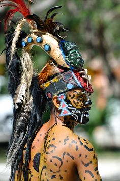 Mayan Warrior in traditional dress, performs an ancient ritual dance