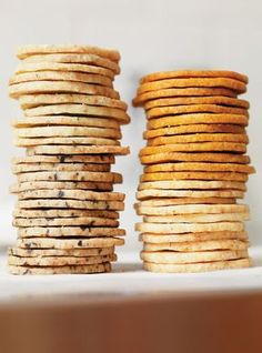 savory french sablé biscuits 4 ways: parmesan cheese, fresh rosemary, hungarian paprika + garlic, black olive + chili pepper