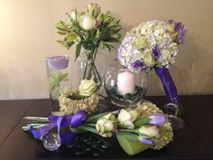 Wildrose Floral Design Hydrangea Collection. Beautiful bridal bouquet in shades of blue/purple, white & green hydrangea accented with green roses and irises. The collection features bridal bouquets, bridesmaid bouquet, and table decor. Prices vary on items selected. Contact Wildrosefloraldesign.net or check it out on Facebook.