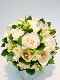 White flowers, accented with green: roses and orchids