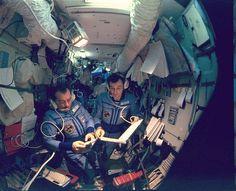 Gennadi Strekalov (left) and Vladimir Dezhurov are pictured at Mir's main command post in the base block. Photo Credit: NASA