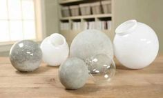 DIY Concrete Balls for your Garden. #gardengoodies #DIYconcrete #concreteprojects #outdoordecoratingprojects BHG http://www.bhg.com/home-improvement/porch/outdoor-rooms/outdoor-decorating-projects/#page=3 #homeandgarden #DIYcraftsandart