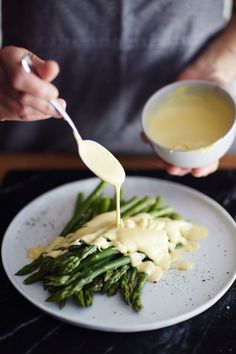 If you love a good hollandaise sauce, whether it's over eggs Benedict on Saturday morning or a plate of asparagus at Easter dinner, then you're a friend of mine. Maybe you didn't even know that this creamy, buttery, slightly tangy sauce that you love so dearly could be made at home in about two minutes using just a blender. Want to impress your friends this weekend? Invite them for brunch and tell them you're making hollandaise sauce.