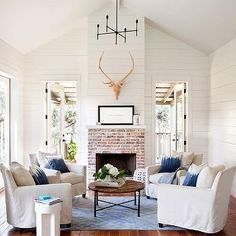 painted black beams with white tongue and groove | ... vaulted ceilings and white wood paneled walls. The focal point
