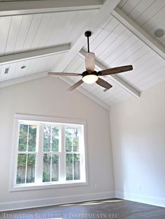 Ceiling, wide plank floors w/ barn doors, brick accent wall in master.