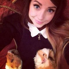 Zoella with her guinea pigs, Pippin & Percy