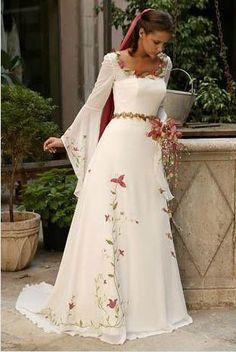 Lindo vestido de noiva medieval com flores.  #casamento #criativo #castelo #medieval #medievalweddings