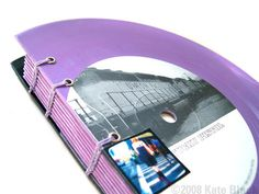 """Handmade book by Kate Black is made from recycled, repurposed 7"""" vinyl records."""
