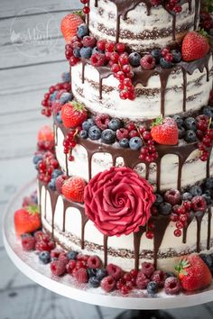 "Closeup of gorgeous ""Lady in Red"" naked Red Velvet drip wedding cake with red berries - by Minh Cakes in Zurich"