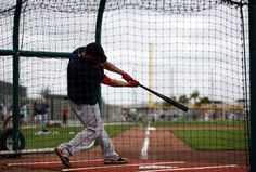 Boston Red Sox's Dustin Pedroia sends a ball flying as he connects during a batting session at baseball spring training in Fort Myers Fla., Wednesday Feb. 25, 2015. (AP Photo/Tony Gutierrez)  Boston Red Sox Team Photos - ESPN