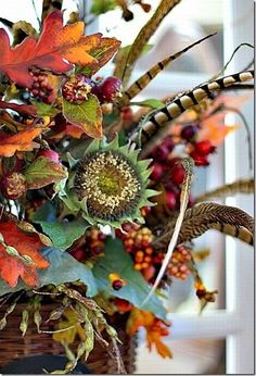 Pheasant Feather Floral Arrangement — this autumn door basket from Pat at Back Porch Musings has lots of autumn floral elements including pheasant feathers.