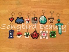 A personal favorite from my Etsy shop https://www.etsy.com/listing/256470032/geeky-keychains-zelda-heart-pokemon