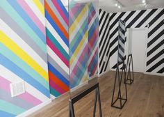Installation of mirrors that reflect colourful stripes by Kim Thome