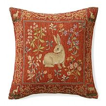Medieval Rabbit   £45  Handsome woven tapestry cushion decorated with a rabbit motif and floral border inspired by the 'Mille Fleurs' background of the 'Lady and the Unicorn' series.