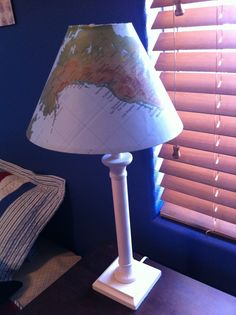 Lamp bought at a yard sale. Then, I purchased a paper map from the Dollar store and cut the map in the pattern of the lamp shade to make the perfect Nautical lamp!