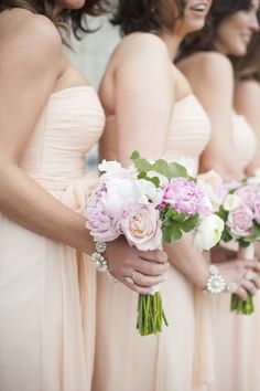 Bridesmaids & Bouquets   See the wedding on SMP: http://www.StyleMePretty.com/2013/11/18/classic-connecticut-wedding-from-justin-and-mary-marantz/   Photography: Justin & Mary Marantz