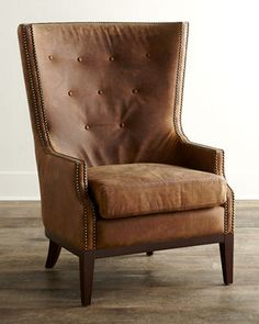 """Oak Leather Chair $1,299.00 EXCLUSIVELY OURS. Handcrafted chair. Rubberwood frame. Top-grain leather upholstery. 35""""W x 35""""D x 46""""T. Seat, 20.875""""T; arms, 24""""T. Imported. Boxed weight, approximately 51 lbs."""