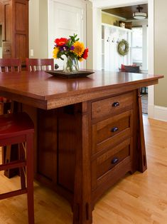 Craftsman style kitchen island with 3 sides of seating