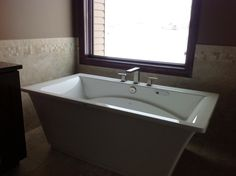 photos of freestanding bathtubs with deck mounted faucets