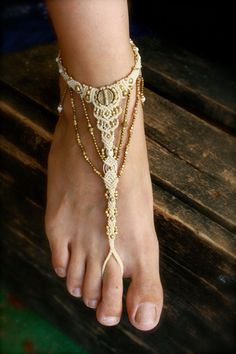 The perfect accessory for your beach wedding - these tribal ethnic barefoot sandals are hand knotted by me using the ancient technique of macrame, sometimes spelled- makrame. ***IMPORTANT** Please choose from the options- one sandal or a pair- prices will be adjusted accordingly I weave them from high quality cream colored waxed cord, with golden brass beads and charms they are ressistant and suited for many environments- made for you to walk in them barefoot on sand, in the forrest, in…