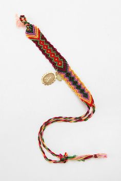 Urban Outfitters Initial Coin Friendship Bracelet (add a charm to a friendship bracelet)
