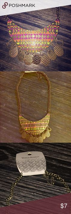 Brand New Tribal-Style Necklace This never-worn necklace is NWT. It's a fun statement necklace that sits right on the chest. It's colors include purple, orange, and neon greenish/yellow. The material itself is metal. Jewelry Necklaces