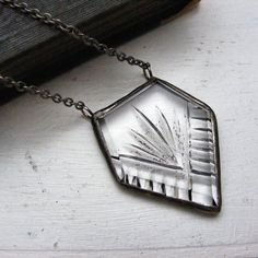 art deco glass pendant | Vintage deco etched glass with the silver foiled backing mostly gone except a bit in the etched area.