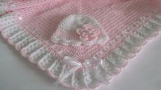 Handmade, lovely crochet blanket, is an ideal covering for your baby.    In Light Pink, decorated with satin ribbon bows in white.