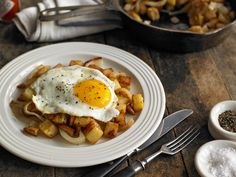 This potato and onion hash is hearty and no-nonsense, substantial comfort food at its simple best Although I tend to cook it just for myself at home, I bet if you gave it to a tableful of people when they came round for supper, they would be weepingly grateful, fashionable dietary restrictions notwithstanding I like a little Tabasco sprinkled over the egg.
