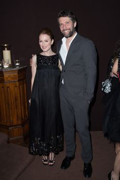 Julianne Moore in Chanel with Bart Freundlich at Chanel and Charles Finch's annual Oscar dinner. [Photo by Tyler Boye]