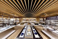 """Completed in 2017 in Hangzhou, China. Images by Dick. By capturing natural light and shadow, Karv One draws inspiration from the highly agrarian image of """"seeds"""" for the design of the new Yan Ji You book. Visual Merchandising, One Photo, Bookstore Design, Auditorium Design, Old Oak Tree, Book Cafe, Modern Restaurant, Commercial Architecture, Chengdu"""