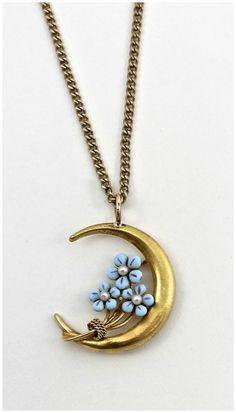 This necklace is made from a converted Victorian pin. The blue flowers are forget-me-nots.