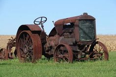 Love this rusty old farm tractor!