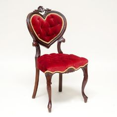 red sweetheart chair: Red velvet sweetheart chair with heart shaped back and wood rose detailing.