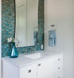 blue glass tile bathroom backsplash, great impact in otherwise monochromatic and works well with vanity set back in a niche