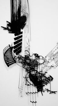 This makes me think of music or sound captured.  by sarah sze
