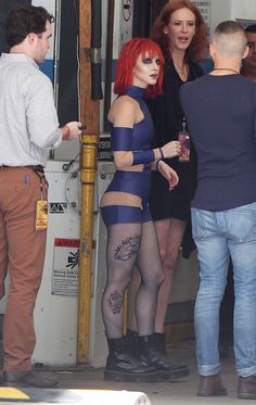 """Is that Hayley Williams on the set of Taylor Swift's new video? See what other friends Taylor tapped to be in """"Bad Blood."""""""