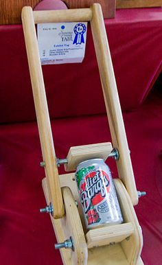 Homemade can crusher, good idea for a 'green-themed' project.