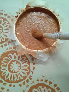 Screen printing on ceramics is a fun way to get patterns and designs on your clay.            what you will need is:   Mod Podge   Em...