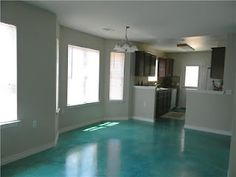 love this turquoise stained concrete floor, but not for whole house. Wonder if it went in a bathroom if we would get tired of the color though. Painted Cement Floors, Concrete Floors, Painting Cement, Floor Painting, Concrete Kitchen, Floor Design, House Design, Acid Stained Concrete, Home Upgrades