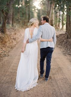 walking arms wrapped around each other. Romantic Australian Engagement from Jose Villa
