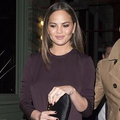 Beauty Chrissy Teigen at Sexy Fish in London wearing EF Collection diamond white topaz triangle ear jackets! Shop now  at saks.com 💛 Xo, EF
