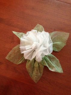 dryer sheets flower, crafts, repurposing upcycling, The finished product For the flower I just folded three dryer sheets lengthwise folded them in half and tied them off Then fluffed them up Just like we used to make tissue flowers in school