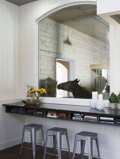 Wouldn't that be cool!  A window in the house with a view in the stable! (bet that window gets dirty ALOT...LOL)