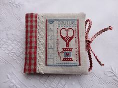 cute cross stitch house key chains.