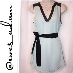 Mint Chiffon sleepless Tunic w/ faux leather trim This beautiful light weight mint sleepless chiffon tunic is perfectly paired with your favorite leather legging to match the faux leather trim. Comes with a black velvet sash and can be worn with or without it. Can fit small to medium or 2 - 6. BCX Tops