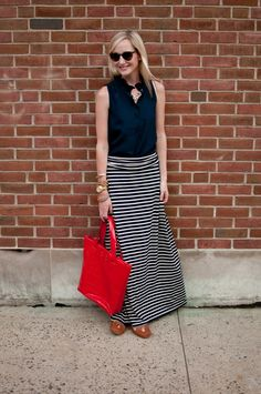 Love this navy maxi skirt and red tote!