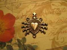 The Seven Sorrows  Bronze Rosary Center by ReSouledForever on Etsy, $5.95
