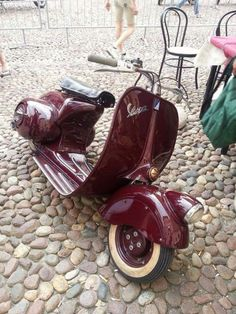 Vespa, vintage, red and shiny.