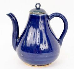 "Chinese, 19th century or earlier. Blue glazed porcelain teapot with thin rounded handle and graceful spout with round lid with pierced finial. Unmarked. Height 5"", width (handle to spout) 4.75""."